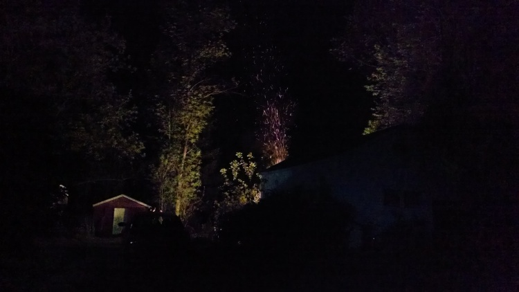 The flames are here hidden by the outbuilding. But look at the light and the sparks rising.
