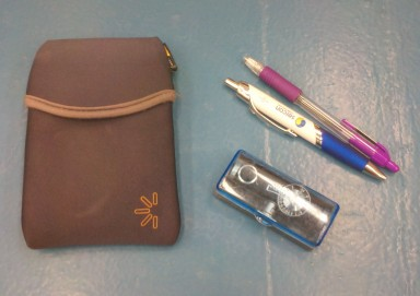 External hard drive. Pretty important. A couple of pens, including my purple grading pen. And a random rangefinder for photography.