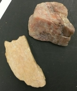 At the light end of the plagioclase scale is the mineral albite. Its rich in the element sodium.