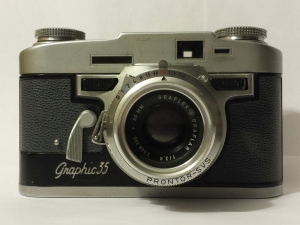 Graphic 35. The black buttons on either side of the lens are the focus.