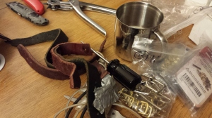 Various buckles and straps. Notice also the omnipresent mug full of my homebrew.