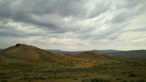 In my blogging spot in the Hanna Basin of Wyoming. If you look really hard, you can see our camp in the lower right.