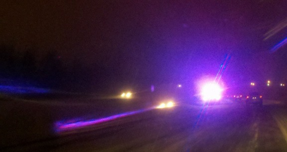 The bright lights there are a state trooper. The headlights to the trooper's left is a car buried in the median.