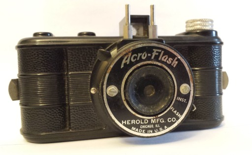 A cheap plastic point and shoot camera, called the Acro-Flash. The shutter is on the lens. There was no focusing this camera.