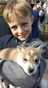 Boy and 5 week old puppy.
