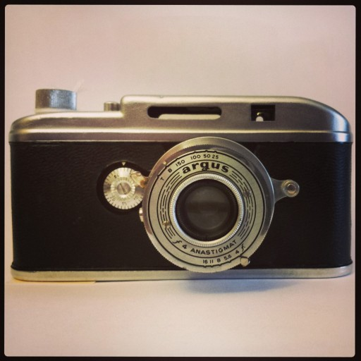 The Argus A3 is a rangefinder camera. You can tell because of the two windows above the lens. In this old camera, the shutter is still on the lens.