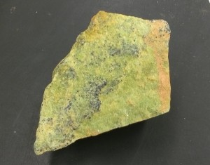 This mineral is called olivine (actually this is a rock, made up of olivine crystals). It's easy to recognise because of its pimento olive color.