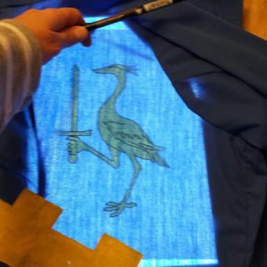 Tracing the heron onto the fabric.