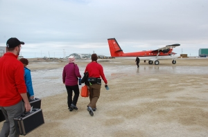 Boarding the twin otter.