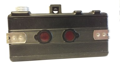 One had to read the frame numbers on the film itself to advance the film properly. The numbers could be read through the red windows.