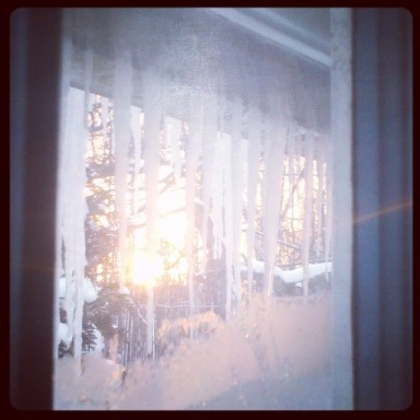 There's the sun, peeking through the icicles, just before sunset.